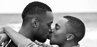 young black men kissing outdoors