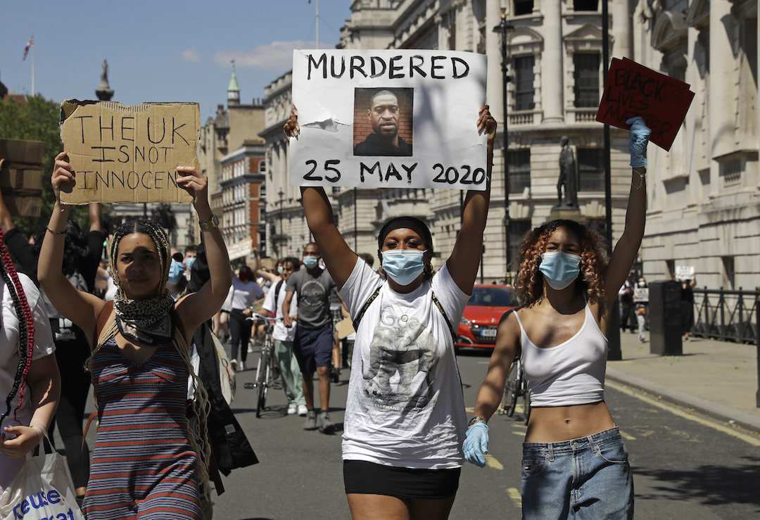 People march towards trafalgar square in central london on sunday, may 31, 2020 to protest against the recent killing of george floyd by police officers in minneapolis that has led to protests across the us. (ap photo/matt dunham)